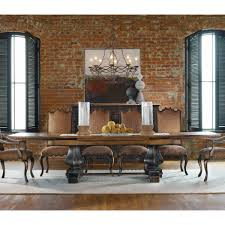 bric wall rustic dining room designs with iron vintage chandelier over teak wood long dining table