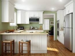 Kitchens with white cabinets and green walls Paint Refreshing White Kitchen Cabinets In Light Green Wall With Two Wooden Stools Kyeanorg Kitchen Refreshing White Kitchen Cabinets In Light Green Wall With