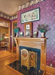 i am obsessed with that fireplace screen like most of the original woodwork