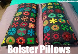 image of two bolster pillows that will be used instead of a traditional toddler bed rail