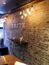 brick wall lighting. wall restaurant interior design bricks reclaimed wood lighting fauxpaint brick d