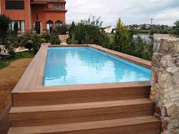 above ground rectangular swimming pools. Simple Pools Swimming Pool Rectangular Above Ground Pool With Wooden Steps Deck  Surrounded By Beautiful Backyard Garden Prices Get Estimation The  Intended Pools 7