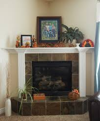 vanessa s fireplace with its tile base and deep corner top ledge