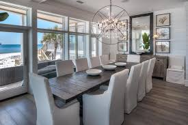 miami beach house dining room style with mirror contemporary chairs shiplap