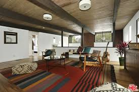 living rooms with brown furniture. The Custom Den Features A Stylish Rug And Seats Along With Hardwood Floors Beams Ceiling. Living Rooms Brown Furniture S