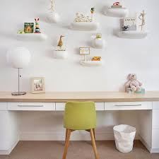 for this colorado children s room joemcguiredesign created a whimsical wall installation with corniche shelves