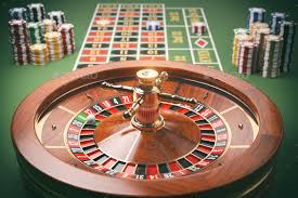 roulette wheel with chips on green table stock photo images