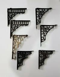 pair of cast iron wall brackets shelf