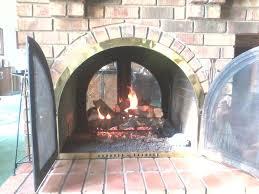 existing see through masonry wood burning fireplace