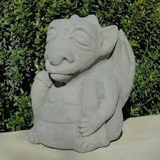 concrete meditating gargoyle statue