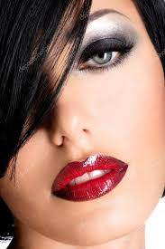 beautiful woman with y red lips and eye makeup stock photo