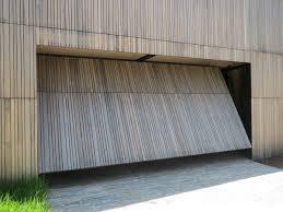 Smartech's Tilt Garage Door system opens as a single panel ...