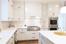 all white kitchen with bronze harwdare view full size