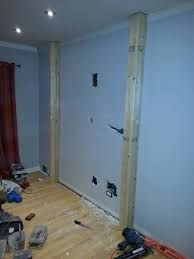 here s the start of the project a blank wall a couple holes and a wooden frame