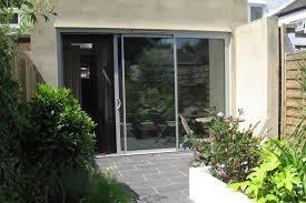 sunflex uk svg30 an extension featuring a 3 panel set of slim sliding doors