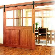 exterior barn door designs. A Large Wooden Barn Door, The Top Half Divided Into Window Panes. This Allows Exterior Door Designs