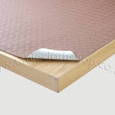 table protector. brown padded table protector