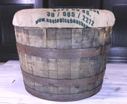 Rustic Storage Ottoman: old whiskey or wine barrel with 3 inch padded top  covered in a reclaimed coffee sack