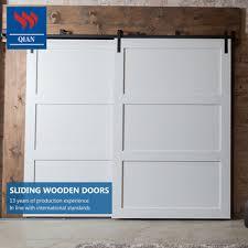double leaf barn doors on one track 2 panel solid haardwood sliding gate design
