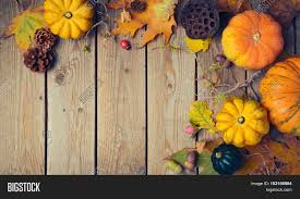 dinner table background. Thanksgiving Dinner Background. Autumn Pumpkin And Fall Leaves On Wooden Table. View From Above Table Background