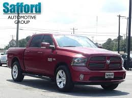 CERTIFIED PRE-OWNED 2014 RAM 1500 4WD CREW CAB 140.5