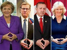Are UK PM Theresa May and German Chancellor Angela Merkel part of the  Illuminati? | protothemanews.com