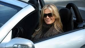 woman driving in convertible car