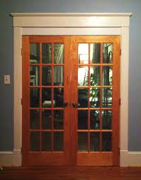 glass double entry doors with brown wooden frames and black metal from modern kitchen glass door
