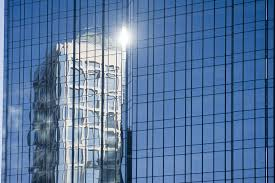 sunny day home office. Urban Office Building Reflected In The Facade Made Of Glass A Skyscraper, Sunny Day Home D