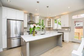 warm white oak flooring a gas fireplace an abundance of recessed lighting and lots of natural light accent the rooms and spaces