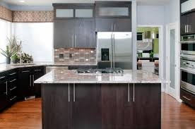 modern kitchen with big island stained wood cabinetarble countertops