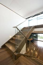 modern staircase with a glass barade and wooden handrails for contrast railing detail stair details dwg glass handrail modern wood railing staircase