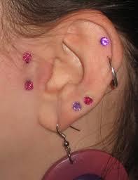 Ear With Lobe And Surface Tragus Piercing Golfiancom