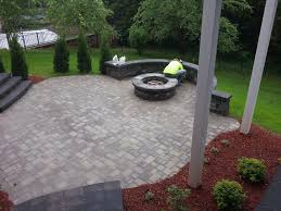 elegant paved patio ideas on a budget for large backyard with round stone fireplace and stylish