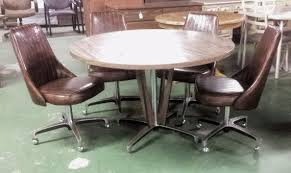 reserved vine chromcraft four swivel chairs mid century modern dinette woodgrain swivel chaire agemodern dining