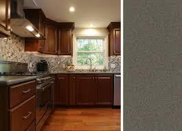 dark cabinets with a gray corian countertop