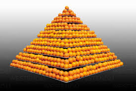 Stack of oranges in pyramid shape against grey background - CSF015212 -  Dieter Heinemann/Westend61