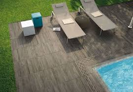 view in gallery wood effect tiles for the pool area
