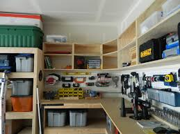 pegboard garage wall storage between diy wood custom garage overhead cabinets and wood workbench for small garage spaces ideas