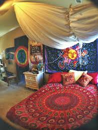 cozy red hippie bedding wih blue hippie bedding on wall also white table with drawers