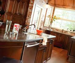 dark cherry cabinets kitchen by diamond cabinetry with light wood floors