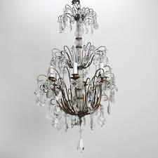 photo of italian three tier crystal chandelier with dark metal frame