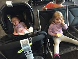 when it was time to board i put the baby in my carrier and a new friend helped me with my gate check items