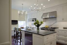 next dining furniture. delighful next white kitchen island fitted with stacked pullout dishwashers and  topped contrasting black countertops next to a dropdown dining table lined in next dining furniture
