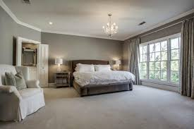 transitional master bedroom. Transitional Master Bedroom With Shaw Carpet - Beige, Hollywood Regency Antique Mirror Nightstand, Chandelier O