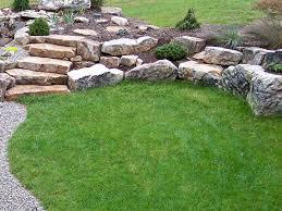 boulder retaining wall creating planting pockets fieldstone slab steps