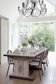 real rustic kitchen table long: the long arm chandeliers add an airy feeling to a breathtakingly airy room with a large pallet dining room tablerustic
