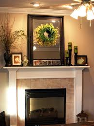fireplace mantel decorations with rectangle frame wall mirror and round green garland also white fireplace mantel