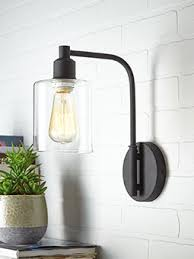 bedroom sconces lighting. canvas arwen wall sconce light adds a sleek and stylish touch to any room features textured black finish with clear glass shade bedroom sconces lighting m