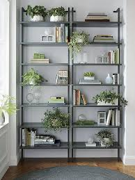 view in gallery potted plants on wall mounted bookcases